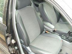 Škoda Octavia 1 udělané autopotahy na míru s funkčni zadni loketni opěrkou