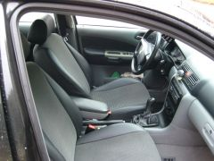 Škoda Octavia1 udělané autopotahy na míru s funkčníi zadní loketní opěrkou