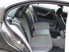 Škoda Octavia1 udělané autopotahy na míiru s funkční zadní loketní opěrkou